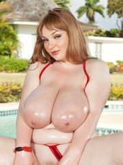 BBW Micky Bells pulls out her knockers and plays with them by the pool