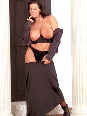 Brunette chick Linsey Dawn McKenzie struts her stuff in black nylons and boots
