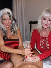 Big boobed older women jerk a guy off together from his POV