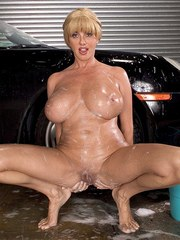 Big boobed mature pornstar Penny Porsche soaps up and toys her pussy