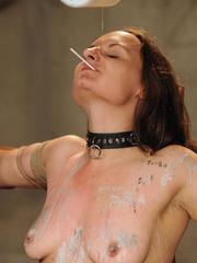 Collared sex slave Nora screams out out as shes whipped and masturbated