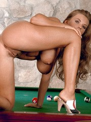 Solo girl Ines Cudna parts her pussy lips after baring her tits on pool table
