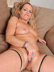 Mature blonde woman Kelly Leigh delves fingers into her horny pussy