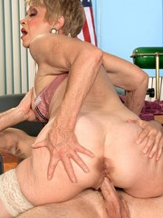 Horny mature woman Lin Boyde seduces a younger man in her office