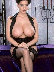 Brunette wife Linsey Dawn McKenzie exposes her hooters wearing black nylons