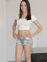 Latina solo girl Francys Belle peels off jeans shorts and panties to pose nude