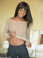 Beautiful black model Ana Foxxx undresses for nude posing