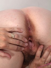 Chubby older woman Francesca peels off her yoga pants to display her beaver