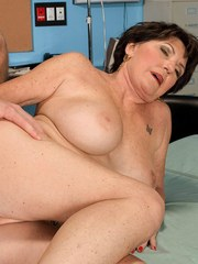 Busty grandma Bea Cummins seduces her gyno doctor in his exam room