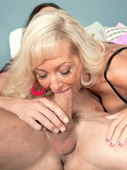 Mature woman Barbi Banks spreads her bare legs for a hard fuck with younger