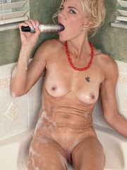 Classy mature lady Barbie Page masturbates in tub after a long day at work