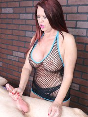 Big boobed lady Grace Evangeline whips and jerks a cock in a mesh bodystocking