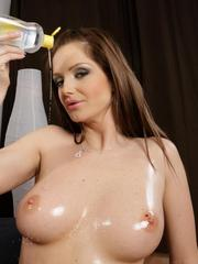 Sexy MILF Sandra Shine oils up after work and before masturbating