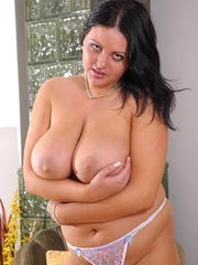 Thick brunette chick with big boobs drives a dildo up her moist pussy