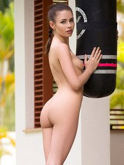 Centerfold model Hilary C puts down boxing gloves to model in the nude