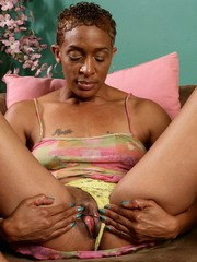 Older ebony female Donni shows off her spread pussy for the first time