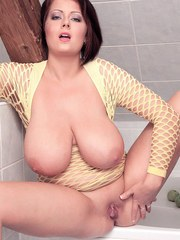 Thick solo girl with huge boobs toys her vagina in the bathtub