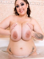 Fat solo girl Allie Pearson wets her huge saggy boobs in the bathtub