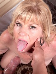 Hot mature lady Dawn Jilling provides her young lover with oral sex