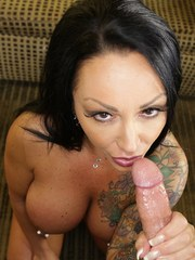 Mature woman with tattoos and pierced nipples jerks and sucks a cock