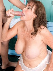 Chunky granny Jacqueline Jolie seduces a young boy in the locker room