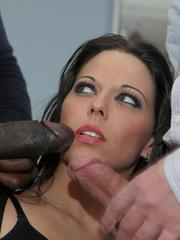 Brunette female Simony Diamond sucks off a black and white cock at once