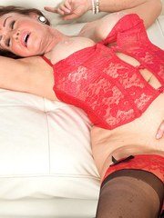 Hot granny Jacqueline Jolie seduces a young boy in hot lingerie and nylons