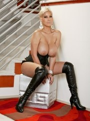 Hot Latina chick Bridgette B displays her knockers in over the knee boots