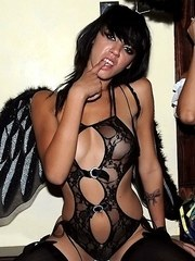 Clubbing chicks in sexy costumes have sex with men and women inside a club