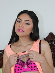 Sweet Latina chick Rose Darling undresses prior to showcasing her bald pussy