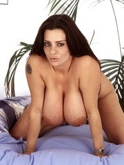 Big boobed chick Linsey Dawn McKenzie spreads her legs to pet her pussy