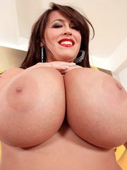 Chubby solo model Leanne Crow unleashes her hooters and eats a banana