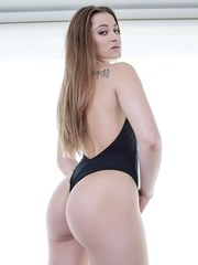 Solo girl Dani Daniels removes swimsuit before plunging her big ass in a tub