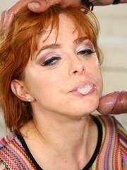 Natural redhead Penny Pax spits out sperm after a tit fuck and blowjob