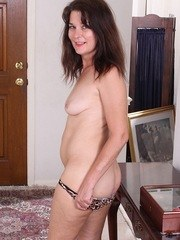 Middle-aged lady Bridget plungers her fingers into her bush after disrobing