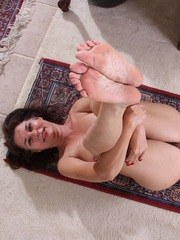 Mature lady does a striptease on way to showing off her hairy muff