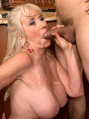 Experienced blonde lady Summeran Winters bangs young boy in the kitchen