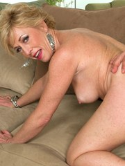 Mature blonde woman with great tits gets banged on a fabric sofa