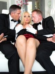 Classy blonde with big tits blows two men in tuxedos at the same time