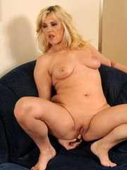 Chubby blonde lady Doreen strips prior to toying her twat on sectional sofa