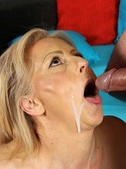 Mature woman fingers her hairy bush while providing oral sex