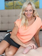 Hot older lady Dani Dare bares her nice tits before tugging on a large dick