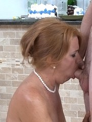 Topless redhead provides oral sex in exchange for a cum facial