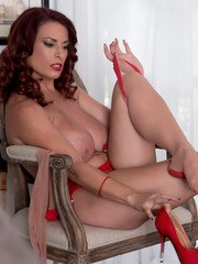 Older MILF Goldie Blair strips off her dress and sexy lingerie ensemble