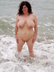 Chubby solo girl Dulcinea romps along a nude beach in her birthday suit