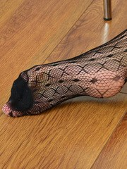 Thin mature lady rips her bodystocking off her body to pose in the nude