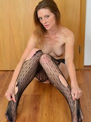 Skinny older lady shreds her bodystocking while getting totally naked