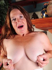 Naughty grandmother Anna unzips her dress and pulls down her crotchless hose