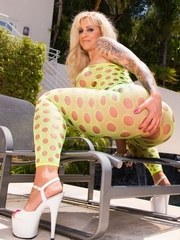 Blonde BBW shows off her naked pussy in a crotchless bodystocking