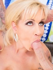 Big boobed blonde gives two guys oral sex at the same time